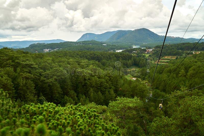 Dalat Cable Car at Robin Hill to the Truc Lam pagoda. Dalat, Vietnam. With damatic clouds. royalty free stock photography