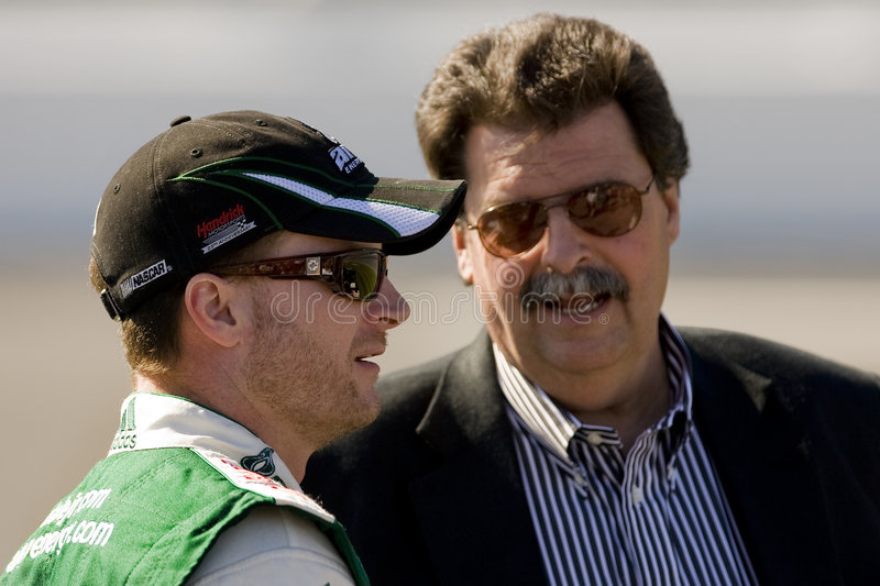 Dale Earnhardt Jr. and Mike Helton. 8 February, 2009 Daytona 500 Daytona Beach, FL - Dale Earnhardt Jr. talks with Mike Helton during qualifying for the Daytona stock image