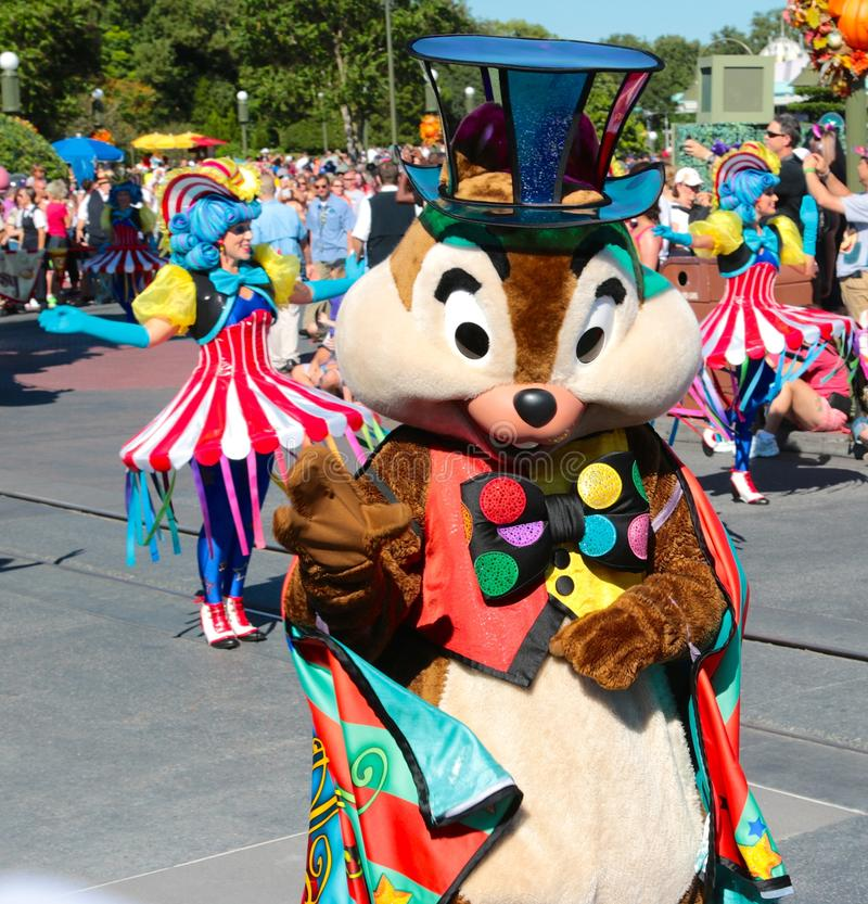 Dale in a street parade at Disneyworld. Dale of Chip and Dale performs in a parade at Disney's Magic Kingdom in Orlando, Florida stock photos