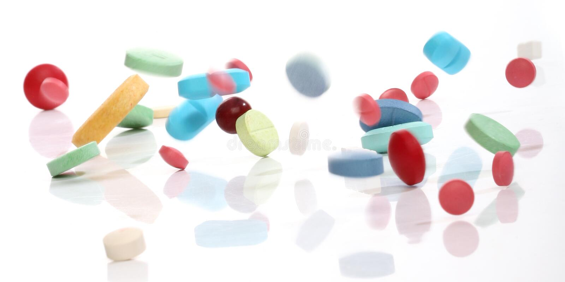 Dalende geneeskundepillen stock fotografie