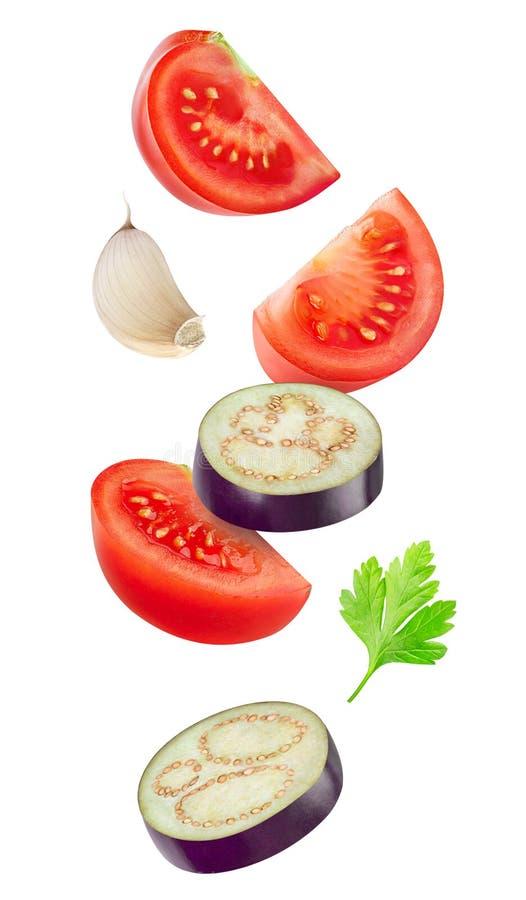 Dalende plakken van tomaat en aubergine royalty-vrije stock fotografie