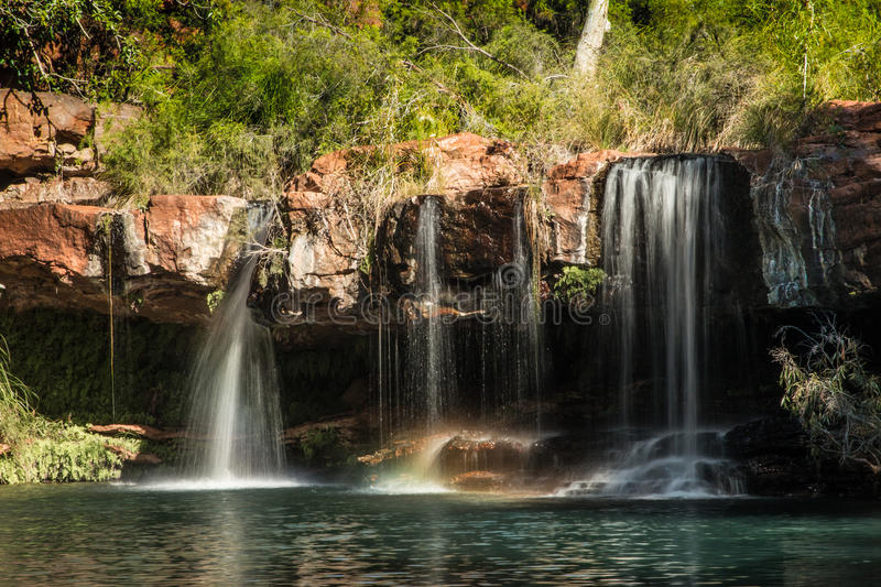 Dales Gorge, falls, Karijini National Park. Dales Gorge in Karijini National Park, carved on ancient sea beds with high content of iron, sedimentary layers on royalty free stock photography