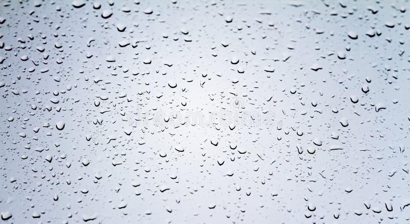 Dalingen van water op glas royalty-vrije stock foto's