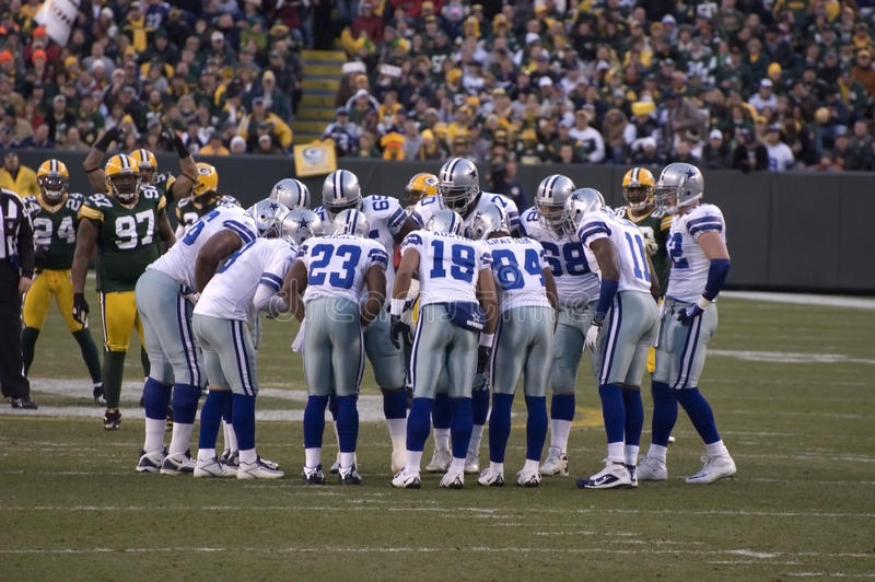 Dallas Cowboys American NFL Football. Dallas Cowboys Offensive Unit Huddles up to call their next play. NFL American sports team football stock photo