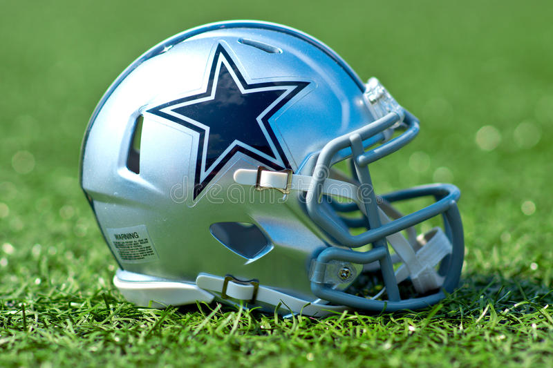 Dallas Cowboys NFL helmet. ZAGREB , CROATIA - 27 AUGUST 2016 - NFL Dallas Cowboys helmet on artificial grass playing turf , product shot stock images