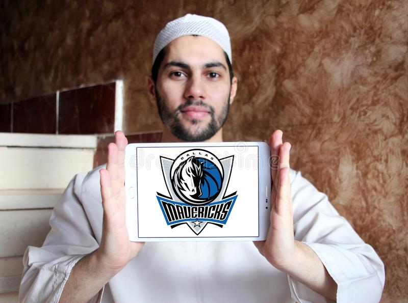 Dallas Mavericks american basketball team logo. Logo of Dallas Mavericks american basketball team on samsung tablet holded by arab muslim man. Dallas Mavericks stock photography