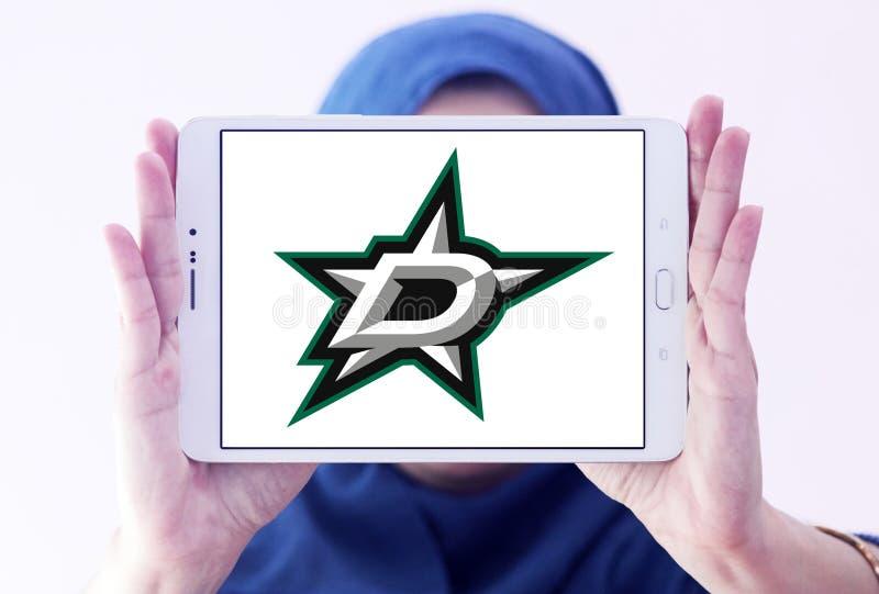 Dallas Stars ice hockey team logo. Logo of Dallas Stars ice hockey team on samsung tablet holded by arab muslim woman. The Dallas Stars are a professional ice royalty free stock image