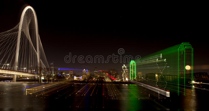 Dallas Texas (abstract). Abstract zoom of downtown Dallas, Texas at night with the Trinity River in the forground royalty free stock photo