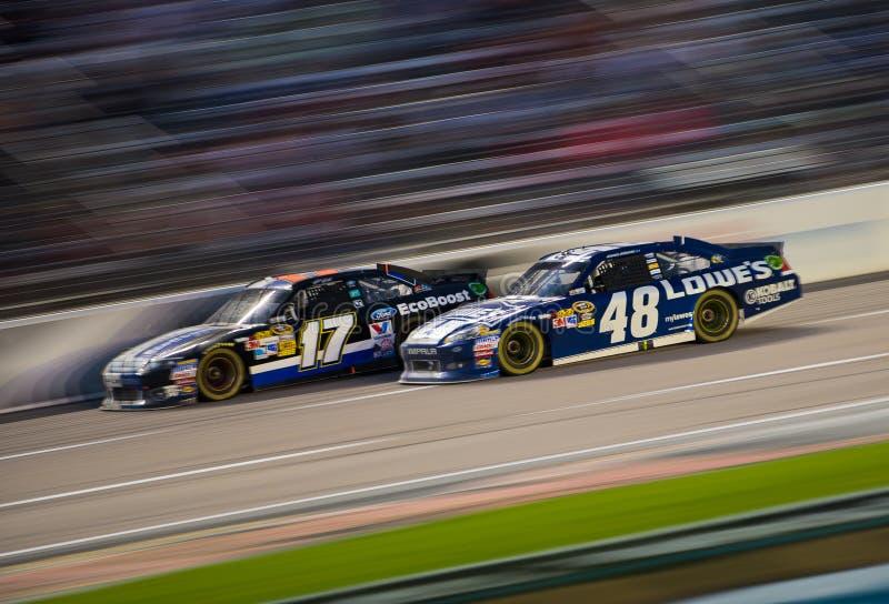 DALLAS, TX - NOVEMBER 04: Jimmie Johnson 48 passing Matt Kenseth 17 at the Nascar Sprint Cup AAA Texas 500 at Texas royalty free stock photos