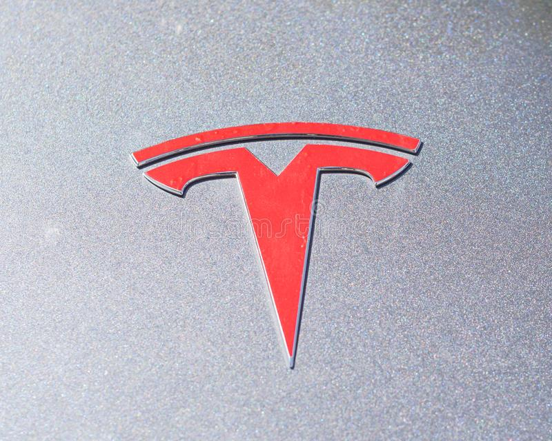 Silver car hood cover with Tesla logo close-up stock photo