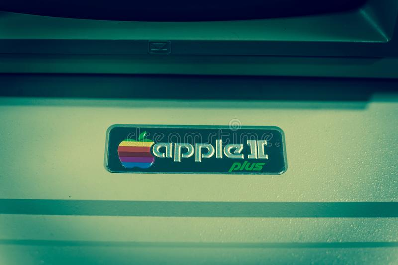 Filtered image close-up logo of old Apple II computer. DALLAS, TX, USA-APR 26, 2019:Vintage tone close-up Apple II logo on foam-molded plastic case. It was the royalty free stock images