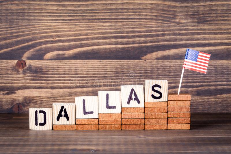 Dallas United States. Politics, economic and immigration concept. Wooden letters and flag on the office desk stock photos