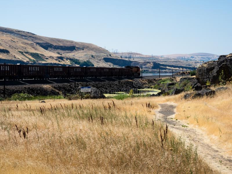 Freight train running along Columbia River Gorge in eastern Washington State stock images