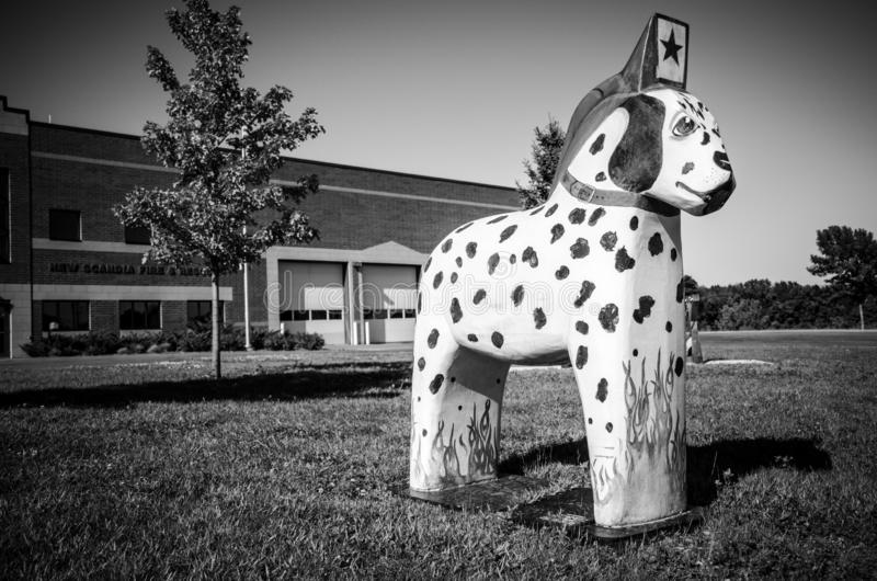 Dalmation dog painted Dala Horse wooden statue sits outside the Scandia Fire Department royalty free stock images