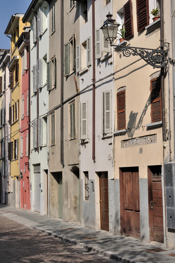 Dalmazia street, parma. Foreshortening of ancient residential buildings aligned on the street in parma citycenter royalty free stock photos
