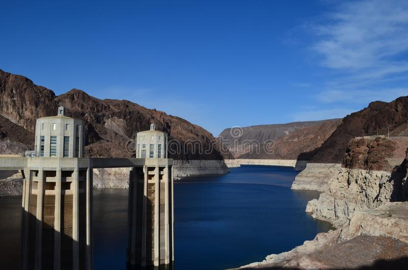 Dam calm day. Calm, cloudless day at the hoover dam with a view of two towers royalty free stock photos