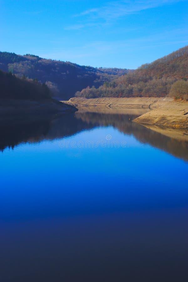 Dam of fades besserve bridge du bouchet. Reflection of blue sky on the reservoir of fades besserve bridge du bouchet, puy de dome stock images