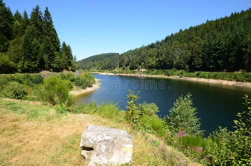 A dam on le Furan river forming beautiful mountain lake, France royalty free stock photography
