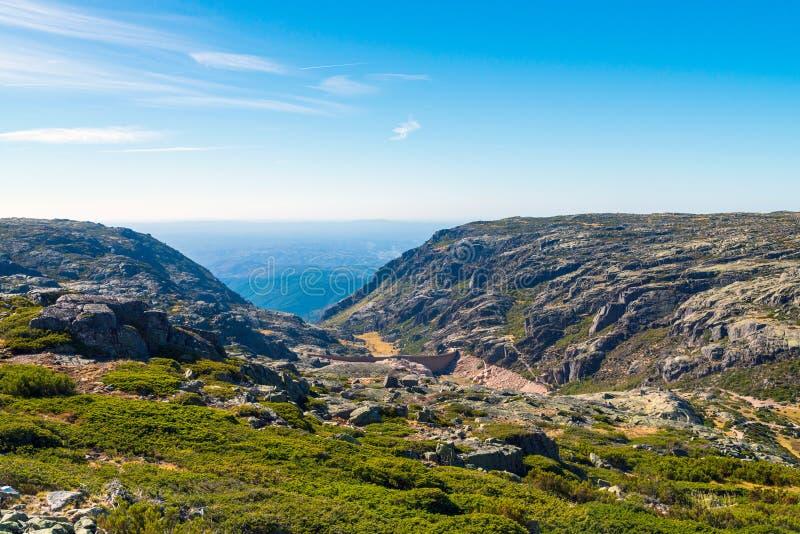 The dam in the mountains, lake and the road. Portugal , Serra da estrela. Concrete, beautiful, clouds, landscape, natural, nature, outdoor, peak, rock, stone stock photo
