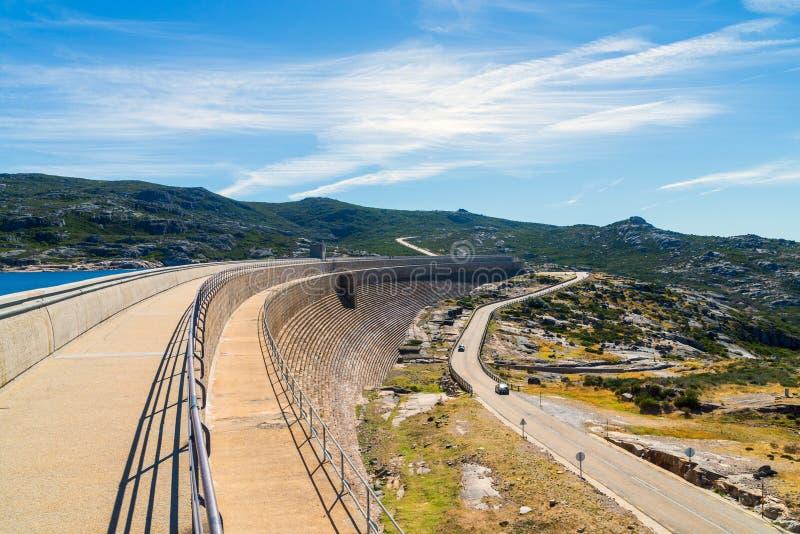 The dam in the mountains, lake and the road. Portugal , Serra da estrela. Concrete, beautiful, clouds, landscape, natural, nature, outdoor, peak, rock, stone stock photography
