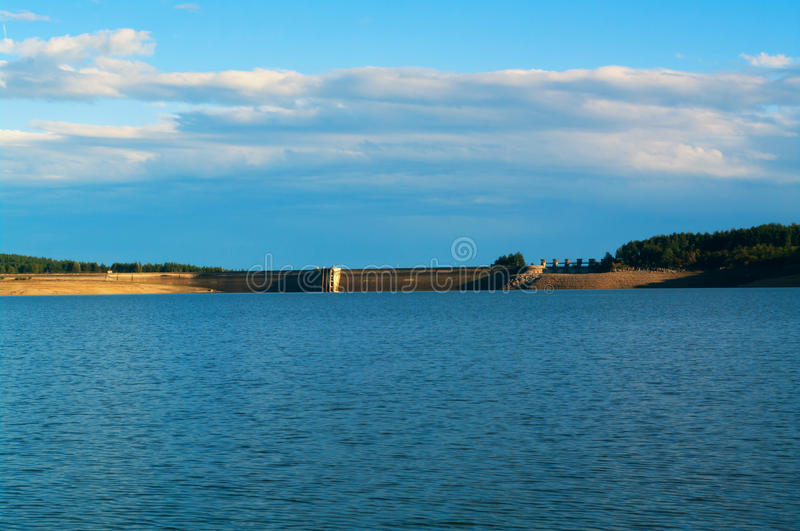 Dam reservoir. Water power plant. royalty free stock photo