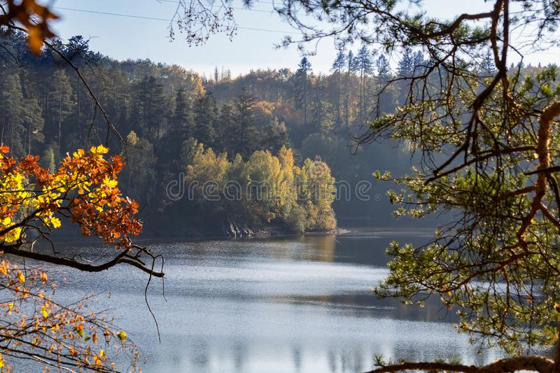 Dam Rimov with autumn colorful trees, Czech landscape.  stock photos