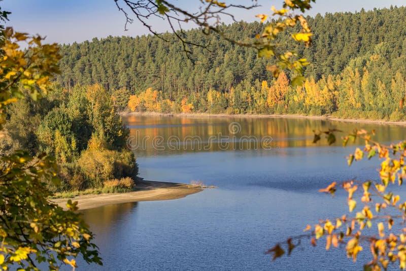 Dam Rimov with autumn peninsula, colorful trees, foiliage, Czech. Landscape stock image