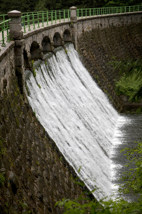 Dam on the river. Lomnica in Karpacz, Poland royalty free stock photos