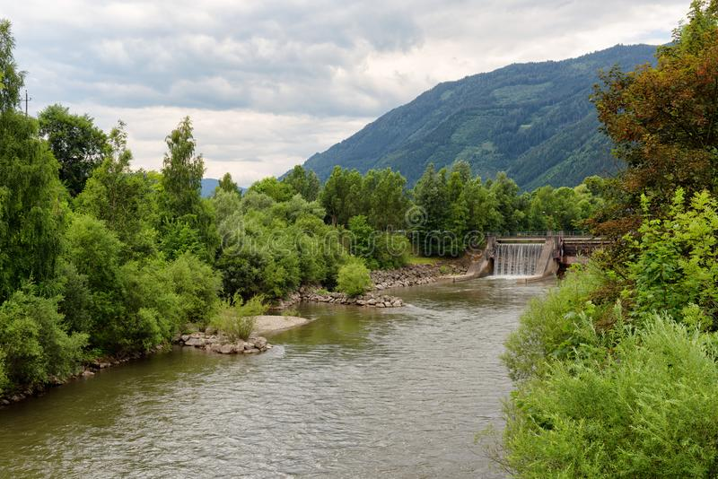 Dam on the river Mur or Mura in Austria. Dam on the Mur river in Austria. The Mur or Mura is a river in Central Europe rising in the Hohe Tauern national park of royalty free stock photos
