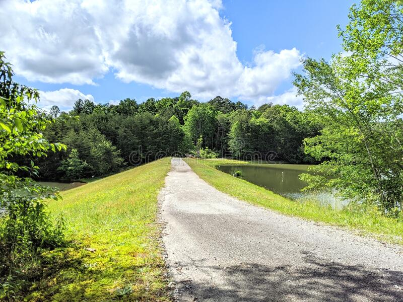 Dam Road Between Two Lakes royalty free stock image