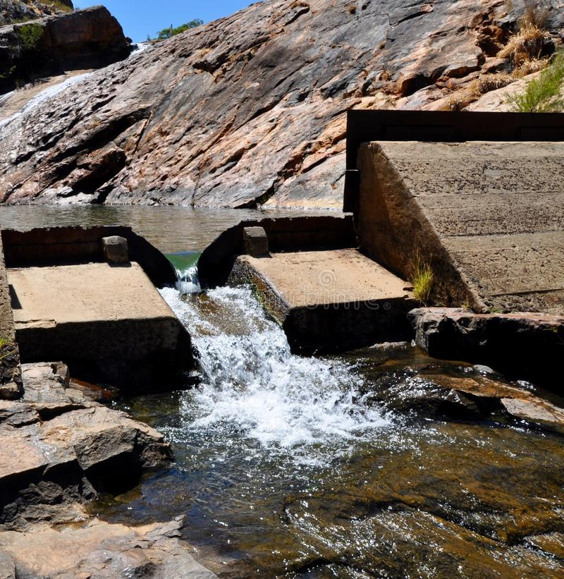 Dam at Serpentine Falls. Closeup of small dam with spillway with rock pools and granite rock formations at Serpentine Falls in Serpentine National Park in stock photography