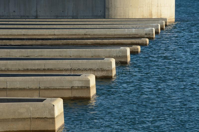 Dam Spillway on reservoir lake stock photo