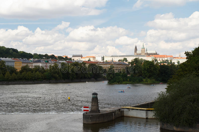The dam on the Vltava River. A view of the Prague. Castle royalty free stock images