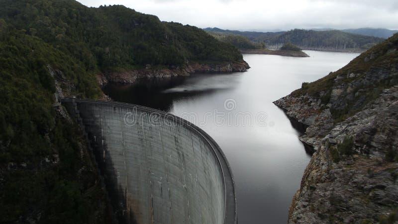 A Dam. A water dam in tasmania, calm and quiet sitting deep inland stock photos