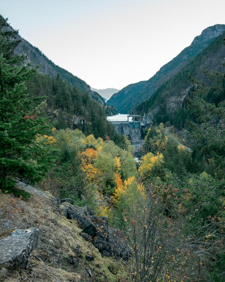 The dam which creates Diablo Lake surrounded by beautiful fall colors stock photo