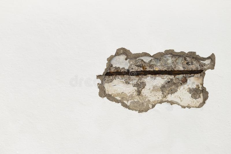 Damage cement wall, crack on white concrete wall. Construction problem royalty free stock image