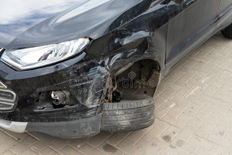 Damage to the front wheel and bumper in an accident. stock images