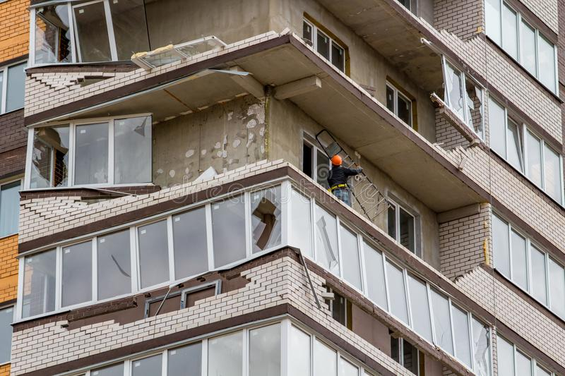 Obninsk, Russia - April 22, 2018: Damage to loggias on a 20-storey house as a result of a strong hurricane wind. Damage to loggias on a 20-storey house as a stock images