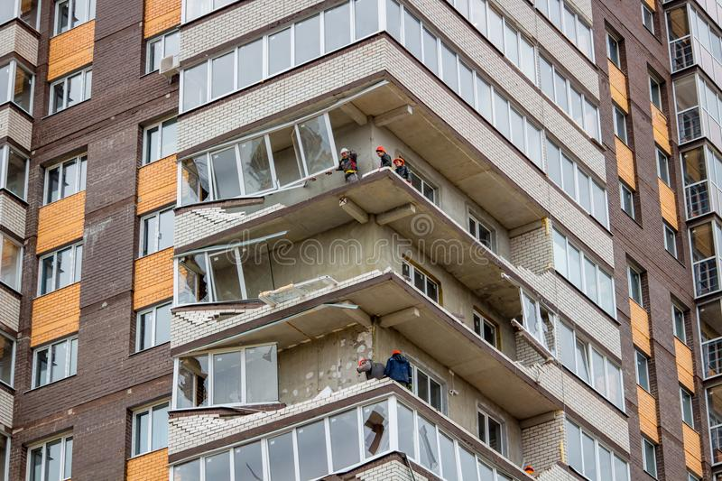 Obninsk, Russia - April 22, 2018: Damage to loggias on a 20-storey house as a result of a strong hurricane wind. Damage to loggias on a 20-storey house as a stock image
