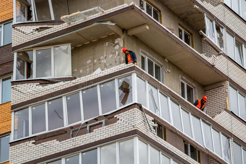 Obninsk, Russia - April 22, 2018: Damage to loggias on a 20-storey house as a result of a strong hurricane wind. Damage to loggias on a 20-storey house as a royalty free stock photography