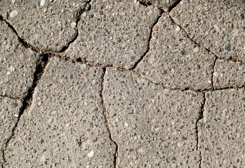 Damaged asphalt texture. Abstract background and texture stock photo