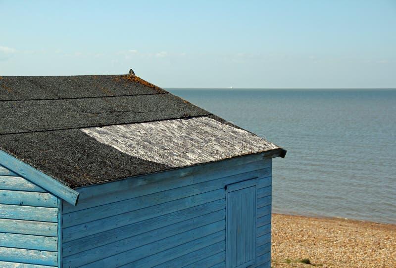 Damaged beach hut roof repair stock photography