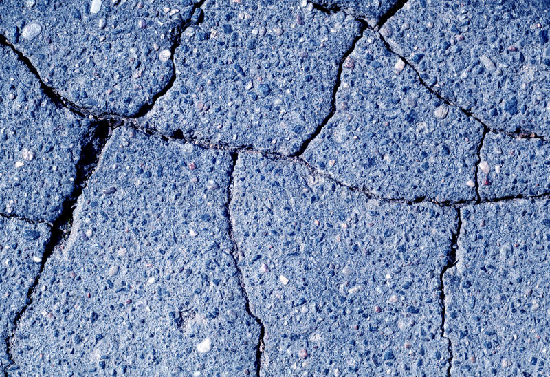 Damaged blue toned asphalt texture. Abstract background and texture stock photos