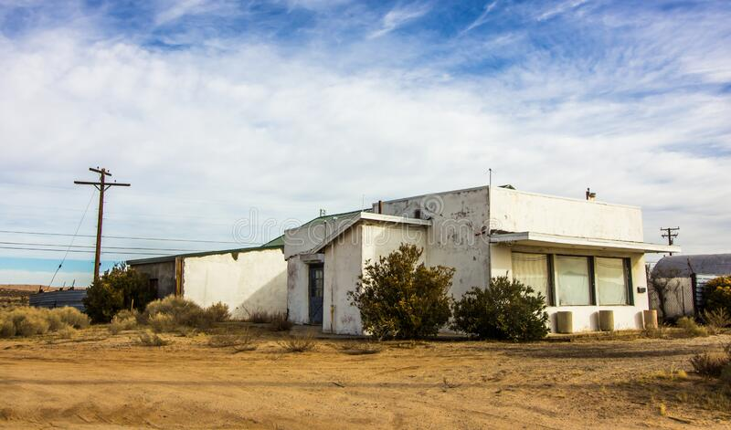 Damaged Building In Depressed High Desert Town. Abandoned Damaged Commercial Building Located In Depressed High Desert Town royalty free stock photos