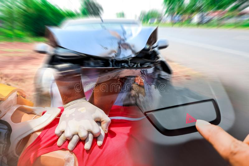Damaged of the car accident after collision with other vehicles automobiles on street,Rescuer CPR first aid for safe life. The finger hitting emergency switch royalty free stock photo