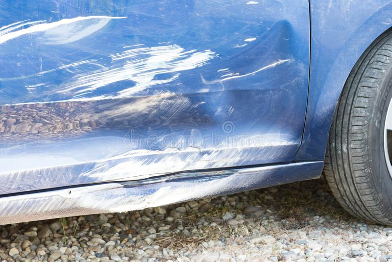Damaged car after an accident. Costly reparation stock photos