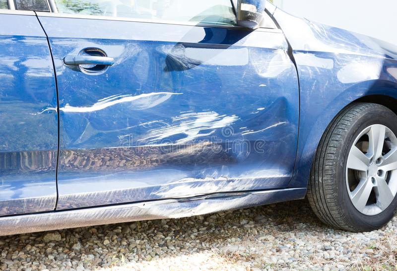 Damaged car after an accident. Costly reparation royalty free stock image
