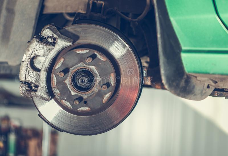 Damaged Car Brake Disc. Awaiting Replacement in Auto Service. Automotive Industry royalty free stock photography