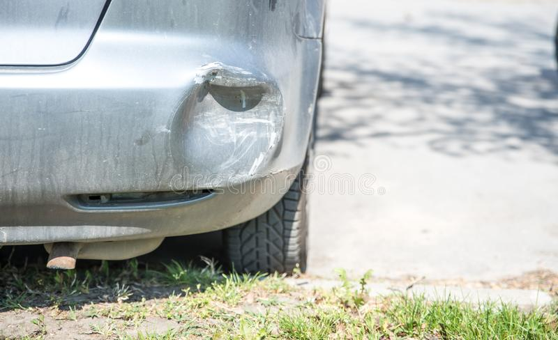 Damaged car with deformation on the rear bumper broken in the traffic road accident and collision while dangerous driving and brak royalty free stock photo