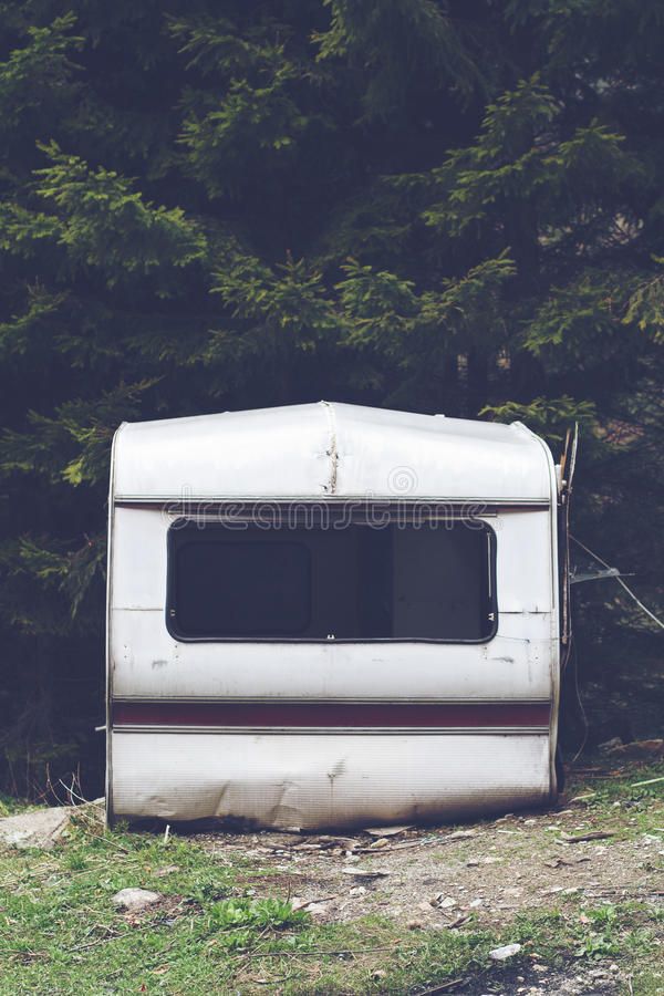 Damaged car trailer in the woods stock images